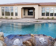 Swimming pool in back yard Stock Image