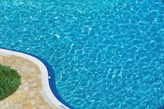 Swimming pool background. Showing border and landscaping royalty free stock photo