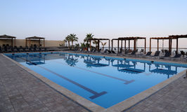 Swimming pool on a background of a sunset Royalty Free Stock Photography