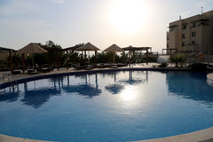 Swimming pool on a background of a sunset, the resort at the Dead Sea, Jordan Stock Photos