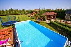 Swimming pool in backyard stock images