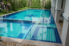 Swimming pool in backyard. Residential swimming pool in backyard Stock Photo