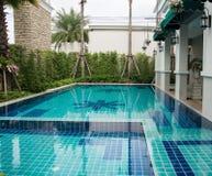 swimming pool in backyard. Residential swimming pool in backyard Royalty Free Stock Photos