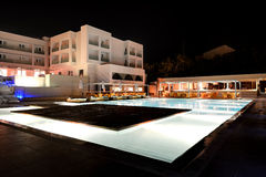 Swimming pool and bar in night illumination Stock Images