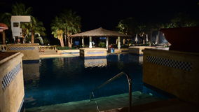 The swimming pool and bar in night illumination at luxury hotel. Sharm el Sheikh, Egypt stock video footage