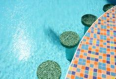 Swimming pool bar stools Royalty Free Stock Photography