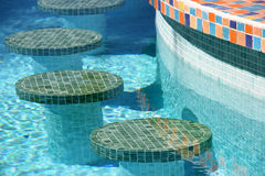 Swimming pool bar stools Stock Photos