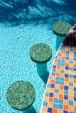 Swimming pool bar stools Royalty Free Stock Image