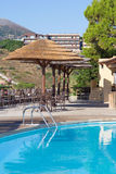 Swimming pool and bar with umbrellas Royalty Free Stock Image