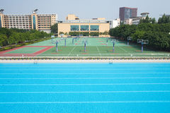 Swimming pool and basketball court Stock Photos