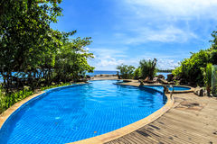 Swimming pool on the beach Royalty Free Stock Images