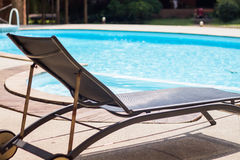 Swimming pool with beach chairs Royalty Free Stock Image
