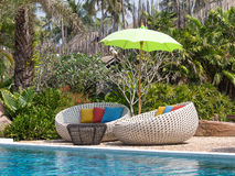 Swimming pool and beach chairs Stock Image