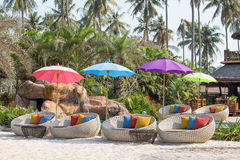 Swimming pool and beach chairs in a tropical garden, Thailand Royalty Free Stock Photos