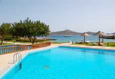 Swimming pool at the beach of luxury hotel Stock Image