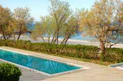 Swimming pool by a beach at the luxury hotel Royalty Free Stock Photography