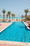Swimming pool at the beach of luxury hotel Royalty Free Stock Photos
