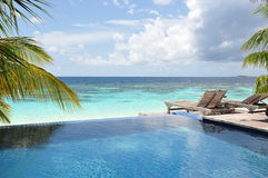Swimming Pool. By the beach in Maldives Royalty Free Stock Photography