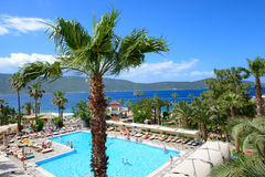 Swimming pool and beach on Mediterranean turkish resort Royalty Free Stock Images