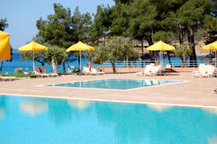 Swimming pool by a beach at the modern luxury hotel Stock Images