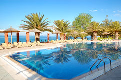 Swimming pool by a beach at the modern luxury hotel. Thassos island, Greece Stock Photography