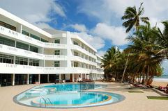 Swimming pool and beach at the popular hotel Stock Image