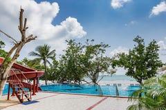 Swimming pool on a beach Stock Photo