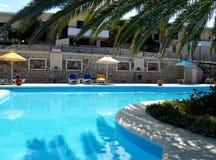 Swimming pool and beach umbrellas. Nice swimming pool in the resort - Crete Stock Photos