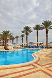 The swimming pool and beach umbrellas Royalty Free Stock Photography