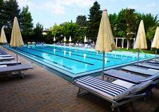 Swimming pool in a beautiful park in Italy royalty free stock image