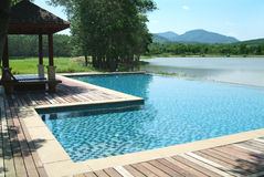 Swimming pool in beautiful sce. Swimming pool at the edge of a lake among mountains in Rayong province, Thailand royalty free stock photos