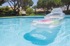 Swimming pool. Beautiful view of a swimming pool with a floating mattress in a resort Royalty Free Stock Photo