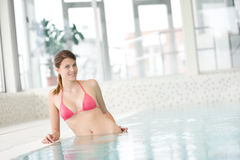 Swimming pool - beautiful woman in bikini Royalty Free Stock Images