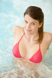 Swimming pool - beautiful woman in bikini Royalty Free Stock Photography