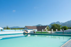 Swimming pool besides mountains Stock Photography