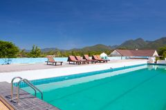 Swimming pool besides mountains Stock Images