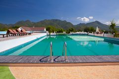 Swimming pool besides mountains Royalty Free Stock Images