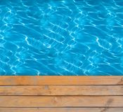 Swimming pool with blue clear water Stock Photos
