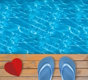 Swimming pool with blue clear water, wooden deck and red paper Stock Images