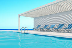 Swimming pool with blue deck chairs, ocean. Row of blue deck chairs along a swimming pool. A cloudless sky is above them. 3d rendering, mock up Royalty Free Stock Images