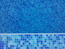 Swimming pool. Blue floor tiles Royalty Free Stock Image