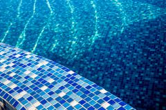 Swimming pool with blue mosaic Stock Images