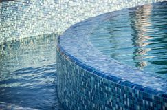 Swimming pool with blue mosaic Stock Photos