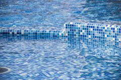 Swimming pool with blue mosaic Royalty Free Stock Photo