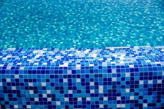 Swimming pool with blue mosaic Stock Photo