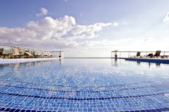 Swimming pool and a blue sky. In summer Royalty Free Stock Image