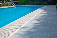 SWIMMING POOL. Blue SWIMMING POOL with stones Royalty Free Stock Photos