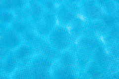 Swimming pool blue tiled surface texture Stock Photography