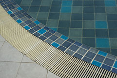 Swimming pool with blue water. Stock Photos