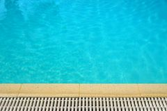 Swimming pool water surface edge background. Swimming pool blue water surface edge background Stock Images